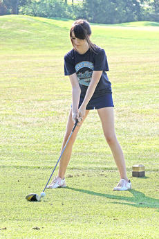 "<div class=""source"">Photo by Jessica Veatch</div><div class=""image-desc"">Brianna Reynolds tees off during a recent golf practice at Rosewood. </div><div class=""buy-pic""><a href=""/photo_select/13721"">Buy this photo</a></div>"