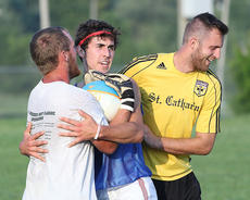 "<div class=""source"">Nick Schrager</div><div class=""image-desc"">Goalkeeper Michael Costello with Satchel Tatum and Derek Cissell share a moment after a goal is scored. </div><div class=""buy-pic""><a href=""/photo_select/36222"">Buy this photo</a></div>"