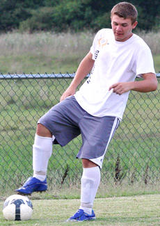 "<div class=""source""></div><div class=""image-desc"">Trevor Hood looks to control the soccer ball in a scrimmage game during a recent practice.</div><div class=""buy-pic""></div>"