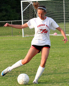 """<div class=""""source"""">Jessica Veatch</div><div class=""""image-desc"""">Lindsey Browning looks to pass the soccer ball to a teammate during a recent practice. Browning and the Lady Knights will open their season Aug. 13 on the road against Berea. </div><div class=""""buy-pic""""><a href=""""/photo_select/21977"""">Buy this photo</a></div>"""
