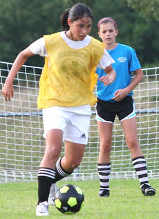 """<div class=""""source"""">Jessica Veatch</div><div class=""""image-desc"""">Noel Obata looks to get by a defender in a recent girls soccer practice.</div><div class=""""buy-pic""""><a href=""""/photo_select/21978"""">Buy this photo</a></div>"""