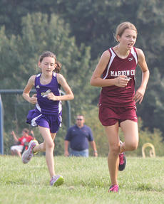 """<div class=""""source"""">Nick Schrager</div><div class=""""image-desc"""">Laurel Brahm breezes past another runner Sept. 12 in Campbellsville.</div><div class=""""buy-pic""""><a href=""""/photo_select/29760"""">Buy this photo</a></div>"""