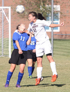 """<div class=""""source"""">Nick Schrager</div><div class=""""image-desc"""">Lady Knights sophomore defender Kristen Mattingly keeps back Lady Hawks sophomore forward Hannah Murray while heading the ball in a Marion County win. More on page B4. </div><div class=""""buy-pic""""><a href=""""/photo_select/29766"""">Buy this photo</a></div>"""