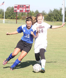 """<div class=""""source"""">Nick Schrager</div><div class=""""image-desc"""">Lady Knights senior defender Bailey Spalding battles Lady Hawk sophomore midfielder Mariah Wiseman for possession of the ball.</div><div class=""""buy-pic""""><a href=""""/photo_select/29768"""">Buy this photo</a></div>"""
