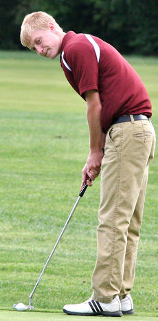 """<div class=""""source"""">Jessica Veatch</div><div class=""""image-desc"""">Junior Evan Dye prepares to sink a putt Saturday at Rosewood Golf Course.</div><div class=""""buy-pic""""><a href=""""/photo_select/22508"""">Buy this photo</a></div>"""