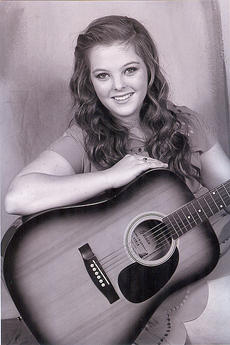 """<div class=""""source"""">Photo submitted</div><div class=""""image-desc"""">Ann-Courtney Thompson of Lebanon competed in the Coca-Cola Talent Classic Semifinals on Aug. 17 at the Kentucky State Fair. The competition is for performers between 13 and 21 years old. Preliminary events were held in 40 counties throughout the state. Thompson performed a vocal and instrumental piece in the contest. </div><div class=""""buy-pic""""></div>"""