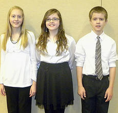 """<div class=""""source"""">Photo submitted</div><div class=""""image-desc"""">Students from St. Charles Middle School earned their way into the Kentucky Junior High School SATB All-State Chorus under the direction of Kandice Spalding. Pictured are, from left, Sara Jean Hughes, Adria Whitfill, and Kelly Durham. They performed at the Kentucky Center for the Arts on Feb. 10.  </div><div class=""""buy-pic""""></div>"""