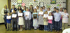 """<div class=""""source"""">submitted</div><div class=""""image-desc"""">The Marion County Conservation District hosted their annual Jim Claypool Art & Writing Banquet Monday, Feb. 21, at the Marion County Extension Office. The 2010 theme was """"Kentucky's Soil- All Hands In."""" Students expressed opinions on how they believe soil helps to contribute to our natural resources, wildlife, and conservation issues through art or a descriptive essay. The winners are, front row, from left, Craig Drury III, Jessy Castillo, Sarahi Castillo, Trevor Mudd, Jane Palagi (art county winner,) Marti Tungate, Mary Beth Thomas, Addie Buckman, Jon Connor Ross and Noah Spalding; back row, Angelia Jewell, Joseph Peterson, Stephanie Farmer, Abby Miles, Hannah Wilson (writing county winner,) Timmy Gillum, Joey Sandusky, Mariella Curtis, Austin Smith and Abbey Ford.  Not pictured are Rachel Gootee, Mya Emmons, Patrick Skaggs, Trent Fenwick, Abby Graves, Abbe George and Rebecca Bowman.</div><div class=""""buy-pic""""></div>"""