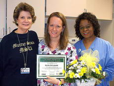 """<div class=""""source"""">Photo submitted</div><div class=""""image-desc"""">Katy Hallmark, RN, Women's Center, was recently named Spring View Hospital's DAISY Award winner. DAISY is an acronym for Diseases Attacking the Immune System. The Foundation was formed in January 2000, by the family of J. Patrick Barnes who died at age 33 of complications of Idiopathic Thrombocytopenic Purpura (ITP).  The DAISY Foundation honors nurses across the country for their outstanding contributions to patient care.  Pictured with Katy are Kathy Ferriell, CNO, and Amaka Oleka, RN, Women's Center Director.</div><div class=""""buy-pic""""></div>"""