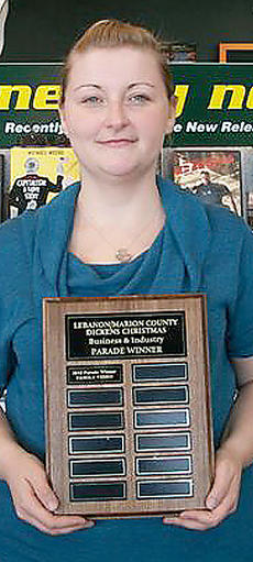 "<div class=""source"">Photo submitted</div><div class=""image-desc"">Amanda Hart, customer service representative of Family Video, accepts the award for winning the 2010 Dickens Christmas Parade Business and Industry Award.</div><div class=""buy-pic""></div>"