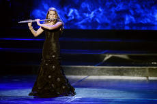 "<div class=""source"">John David Mercer, Staff Photographer, Press-Register</div><div class=""image-desc"">Paige Wilson performs ""Concertino"" by Cecile Chaminade on the flute during the talent portion of the competition.</div><div class=""buy-pic""></div>"