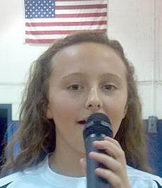 """<div class=""""source"""">Photo submitted</div><div class=""""image-desc"""">Elizabeth Hughes sings the National Anthem before the St. Charles Middle School girls basketball game Sept. 4. </div><div class=""""buy-pic""""></div>"""