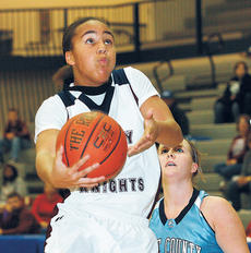 """<div class=""""source"""">Jessica Veatch</div><div class=""""image-desc""""> Sophomore Makayla Epps goes in for a lay-up in route to her career high 37 points in last Wednesday's game against Boone County in the Republic Bank Classic.</div><div class=""""buy-pic""""><a href=""""http://web2.lcni5.com/cgi-bin/c2newbuyphoto.cgi?pub=015&orig=Epps.jpg"""" target=""""_new"""">Buy this photo</a></div>"""