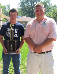 """<div class=""""source"""">Photo submitted</div><div class=""""image-desc"""">Tyler Jones, pictured with instructor Brian Jarvis, competed in the state tractor driving contest at the Kentucky Leadership Training Center July 15 with nine other participants across the state.  The competition consisted of navigating a tractor through an obstacle course as quickly and safely as possible.  Tyler won $150 and a trophy for his efforts.</div><div class=""""buy-pic""""></div>"""