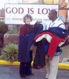 """<div class=""""source"""">Photo submitted</div><div class=""""image-desc"""">The Marion County Farm Bureau Women's Committee made a donation of coats to the Wayside Christian Missions. In this photo, Nancy Harmon, women's chairperson, helps unload the many coats donated locally to the mission. </div><div class=""""buy-pic""""></div>"""