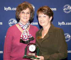 """<div class=""""source"""">Submitted</div><div class=""""image-desc"""">Nancy Harmon (left), chair of the Marion County Farm Bureau Women's Committee, accepts the 2010 Gold Star Award of Excellence from Frieda Heath, chair of the Kentucky Farm Bureau state Women's Committee. The award was presented during a Dec. 3 recognition program at the 91st Kentucky Farm Bureau annual meeting.</div><div class=""""buy-pic""""></div>"""