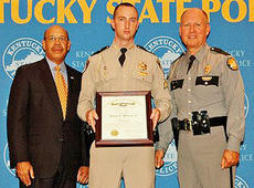 "<div class=""source"">Photo submitted</div><div class=""image-desc"">Kentucky State Police Commercial Vehicle Enforcement Officer James Medley (center), a resident of Bardstown and native of Lebanon, received his promotion certificate from Justice and Public Safety Cabinet Secretary J. Michael Brown (left) and KSP Commissioner Rodney Brewer (right). Medley was promoted to sergeant on Aug. 16, and will remain assigned to the CVE Program Support Branch in Frankfort. A seven-year veteran of the agency, Medley is a 1998 graduate of Bethlehem High School and a 2002 graduate of Eastern Kentucky University. He is the son of James and Kimberly Medley of Lebanon. </div><div class=""buy-pic""></div>"