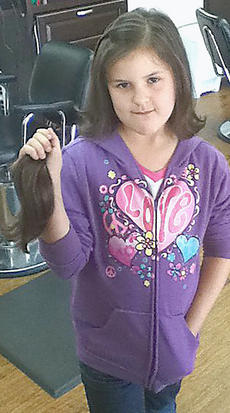 "<div class=""source"">Photo submitted</div><div class=""image-desc"">Andrea Bright, daughter of Robert and Lisa Bright of Loretto, recently donated 10 inches of hair to Locks of Love. Candi at Ovations Salon, Campbellsville Highway, Lebanon, provided the cut.</div><div class=""buy-pic""></div>"