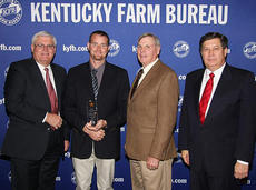 """<div class=""""source"""">Photo submitted</div><div class=""""image-desc"""">Curtis Jones, Young Farmer Chair for Marion County Farm Bureau (center left), accepts the Gold Star Award of Excellence from Mark Haney, Kentucky Farm Bureau President (left). Also pictured are Larry Elder, President of Marion County Farm Bureau (center right), and David S. Beck, Kentucky Farm Bureau Executive Vice President (right). The award was presented during a De. 7 recognition program at the 93rd Kentucky Farm Bureau annual meeting.</div><div class=""""buy-pic""""></div>"""