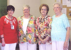 "<div class=""source"">Photo submitted</div><div class=""image-desc"">Ann Metcalf, postmaster for Bradfordsville, was recently honored by friends and family at a retirement reception held in her honor. Pictured are the four living postmasters who served a combined total of 123 years of service for the United States Postal Service. They are, from left, Ann Metcalf, 28 years; Faye Carol Cochran, 33 years; Peggy Wilcher, 25 years, and Louise Gribbins, 37 years.