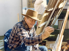 """<div class=""""source"""">Submitted</div><div class=""""image-desc"""">In Ham Days past local artists would set up booths around Court Square. Local artist Mr. Rawlings is shown here in 1985 working on one of his paintings.</div><div class=""""buy-pic""""></div>"""