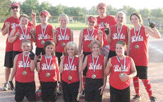 """<div class=""""source"""">Photo submitted</div><div class=""""image-desc"""">The Reds recently earned the title of Girls Little League Softball 9-12-year-old champions. Pictured, kneeling from left, are Mariella Curtis, Eden Kessler, Cara Piecarski, Kelsey Raikes and Jenna Cecil; standing from left, Leslie Gammon, Kenna Luckett, Alice Farmer, Gabby VanWhy, Morgan Mattingly and Kendall Benningfield. Also pictured are assistant coach Mike Benningfield and head coach Jonathan Spalding.</div><div class=""""buy-pic""""></div>"""