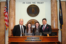 """<div class=""""source"""">Photo submitted</div><div class=""""image-desc"""">State Rep. Terry Mills, left, and House Speaker Greg Stumbo joined with their colleagues in the House on Wednesday, Feb. 6, to welcome Katelyn and Samantha Daugherty of Lebanon as they sang the national anthem during the House's opening ceremonies. Here, all four are pictured at the front of the chamber.  </div><div class=""""buy-pic""""></div>"""