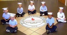 "<div class=""source"">Photo submitted</div><div class=""image-desc"">Pictured are the 2011 St. Augustine School kindergarten graduates Peter Riggs, David Carter, Kelli Jo Johnson, Lauren Bradshaw, Henry Mattingly, Phoenix Boone, and Carter Ballard.</div><div class=""buy-pic""></div>"