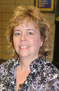"""<div class=""""source""""></div><div class=""""image-desc"""">Pictured is Alicia Riggs, St. Augustine Principal.</div><div class=""""buy-pic""""><a href=""""/photo_select/13748"""">Buy this photo</a></div>"""