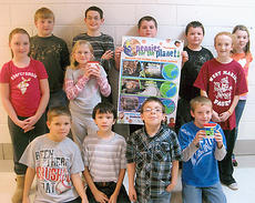 """<div class=""""source"""">Photo submitted</div><div class=""""image-desc"""">West Marion Elementary fourth-grade science students recently collected over $400 for """"Pennies for the Planet"""" as a conservation project to help preserve and protect three endangered habitats located in the United States. Pictured are, from back left, Gregory Greenwell, Eli Medley, Dalton Sibley, Zachary Wells and Destiny Adkins; middle, Kailey Nally, Ashley Cissell and LeeAnn Jones; kneeling, Chase Miles, Jorge Hernandez, Christian Elder and Jacob Hawkins.</div><div class=""""buy-pic""""></div>"""