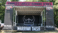 "<div class=""source"">Stephen Lega</div><div class=""image-desc"">The stage is set for Warrior Dash Kentucky</div><div class=""buy-pic""><a href=""http://web2.lcni5.com/cgi-bin/c2newbuyphoto.cgi?pub=015&orig=WD%2BEve-stage.jpg"" target=""_new"">Buy this photo</a></div>"