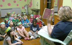 "<div class=""source"">Stephen Lega</div><div class=""image-desc"">Behind the St. Charles stage, Kristi Peterson's kindergarten students listened as Kim Hagan read them a story.</div><div class=""buy-pic""><a href=""/photo_select/11594"">Buy this photo</a></div>"