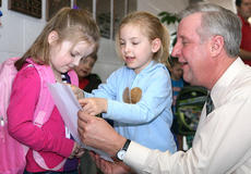"<div class=""source"">Stephen Lega</div><div class=""image-desc"">As the West Marion students were preparing to leave, preschooler Trinity Perry (center) wanted to show her artwork to St. Charles Principal John Brady. Perry's classmate, Rayne Chowning wanted to see the art as well.</div><div class=""buy-pic""><a href=""/photo_select/11595"">Buy this photo</a></div>"