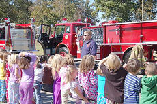 "<div class=""source"">Photos submitted</div><div class=""image-desc"">Pictured is a Loretto firefighter speaking to students at West Marion Elementary School. Also pictured is Samantha Smith trying to escape during a simulation of a house fire.</div><div class=""buy-pic""></div>"