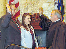 """<div class=""""source"""">Photo submitted</div><div class=""""image-desc"""">Hannah Wilson, daughter of Cindy and Todd Wilson of Bradfordsville, attended the swearing-in of State Senator Jimmy Higdon. Chief Justice John D. Minton, Jr. performed the ceremony.</div><div class=""""buy-pic""""></div>"""