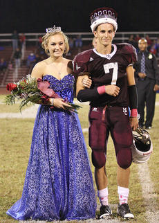"<div class=""source""></div><div class=""image-desc"">Seniors Michael Walls and Morgan Clark were crowned Marion County High School's football homecoming king and queen at halftime of the football game against Mercer County Friday night.  </div><div class=""buy-pic""></div>"