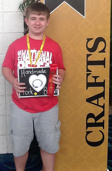 "<div class=""source"">Photos submitted</div><div class=""image-desc"">Logan Votaw, recent graduate from West Marion Elementary, has had one amazing year. He began the school year by telling his mom that since it was going to be his last year at WMES, he was going out with a bang. He was invited to join the Jr Beta Club (WMES is the only elementary in Marion County with a Beta Club) where he participated in club meetings and in February, went to the state convention. It was at that state competition where Votaw made good on his promise to ""go out with a bang."" He had made a bracelet from an old fork and entered it in the handmade jewelry competition. He placed third - the first elementary from Marion County to ever place at state - and was invited to attend the national competition. Votaw, his family, and Kevin Durham, the school's Beta Club sponsor, all made the trip to Mobile, Ala., for Jr. Beta National Convention June 15, where he entered his bracelet in competition. This time, he really made a bang by placing second. Yes, Logan has made quite a bang, and in doing so, made quite a name for Marion County and WMES. Watch out St. Charles Middle School. Votaw will be there in the fall!</div><div class=""buy-pic""></div>"