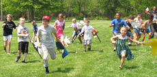 "<div class=""source"">Photos submitted</div><div class=""image-desc"">Children, ages six and up, race for the finish line during the Kids Derby race. </div><div class=""buy-pic""></div>"