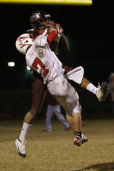 """<div class=""""source"""">Jesse Osbourne</div><div class=""""image-desc"""">Bryson Bell wrestles for the ball as he comes down in the end zone with seven seconds remaining. Bell's touchdown put the Knights up for good 42-39. </div><div class=""""buy-pic""""><a href=""""/photo_select/3932"""">Buy this photo</a></div>"""