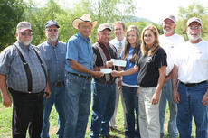 "<div class=""source"">Photo submitted</div><div class=""image-desc"">Marion County Animal Shelter employees accept a $500 check from the Kentucky Cattlemen's Foundation and a $250 check from the Marion County Cattlemen.  Pictured, from left, are Paul Peterson, cattle farmer; Larry Caldwell, magistrate; Gene Lanham, Marion County Cattlemen's Association president; Steve Downs, cattle farmer, John G. Mattingly, county judge/executive; Sarah Gribbins, Marion County Animal Shelter employee; Kay Turpin, Marion County Animal Shelter employee, Joe Bernard Luckett, cattle farmer; and Gary Ford, cattle farmer.</div><div class=""buy-pic""></div>"