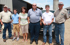 "<div class=""source"">Photo by Stephen Lega</div><div class=""image-desc"">The Marion County Cattlemen's Association presented a $1,000 scholarship to Michael Sandusky (second from right) during the Marion County Extension Field Day on June 20. Steve Downs (far left) and Gene Lanham (far right) presented the check on behalf of the association. Sandusky's parents and brother were also on hand for the presentation. </div><div class=""buy-pic""><a href=""/photo_select/28166"">Buy this photo</a></div>"