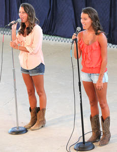"""<div class=""""source"""">RANDY PATRICK/The Kentucky Standard</div><div class=""""image-desc"""">Katelyn and Samantha Daugherty, 16-year-old sisters from Lebanon, were the first performers in the Coca Cola Talent Contest at the Nelson County Fair, Thursday, July 17. They sang """"Say Something by Christina Aguilera.</div><div class=""""buy-pic""""><a href=""""http://web2.lcni5.com/cgi-bin/c2newbuyphoto.cgi?pub=015&orig=daugherty_girls_talent.jpg"""" target=""""_new"""">Buy this photo</a></div>"""
