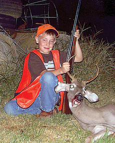 """<div class=""""source"""">Submitted</div><div class=""""image-desc"""">Dustin Gordon, age 8, killed his first doe and 5-point buck during the first day of youth hunt. He is the son of Barry and Chequita Gordon of Raywick.</div><div class=""""buy-pic""""></div>"""