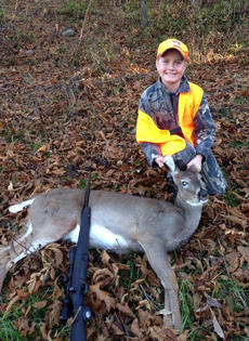 """<div class=""""source"""">Photo submitted</div><div class=""""image-desc"""">Hunter Hall killed his first deer while hunting with his dad recently. </div><div class=""""buy-pic""""></div>"""