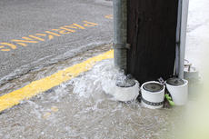 """<div class=""""source"""">Nick Schrager</div><div class=""""image-desc"""">Heavy rains Monday afternoon sent water pouring over streets in downtown Lebanon.</div><div class=""""buy-pic""""><a href=""""/photo_select/27979"""">Buy this photo</a></div>"""