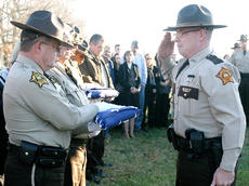 "<div class=""source"">Stephen Lega</div><div class=""image-desc"">An American flag draped Deputy Anthony Rakes' coffin. After it was folded, Adam Rainwater, right, of the Green County Sheriff's Department presented the flag to Marion County Sheriff Jimmy Clements.</div><div class=""buy-pic""><a href=""http://web2.lcni5.com/cgi-bin/c2newbuyphoto.cgi?pub=015&orig=rakes%2Bfuneral%2Bpic%2B28.jpg"" target=""_new"">Buy this photo</a></div>"