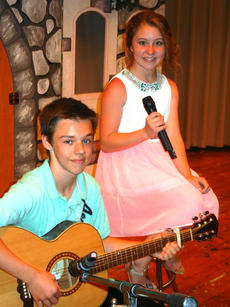 """<div class=""""source"""">Photos submitted</div><div class=""""image-desc"""">Guitarist Haydn Wells accompanied vocalist, Layla Cambron, as they performed """"She Will Be Loved"""" by Maroon Five. </div><div class=""""buy-pic""""></div>"""