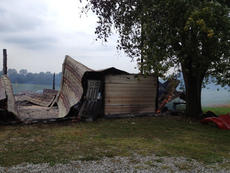 "<div class=""source"">Photo submitted</div><div class=""image-desc"">Deanna Thornton submitted this photo of her and her husband's barn, which caught fire after being struck by lightning Tuesday afternoon.</div><div class=""buy-pic""></div>"