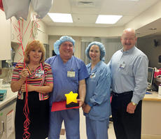 """<div class=""""source"""">Photo submitted</div><div class=""""image-desc"""">Larry Belden, OR transporter, is Spring View Hospital's """"Celebrity of the Quarter"""" for the second quarter of 2014, representing clinical services. Pictured with Belden are Linda Hunter, CNO, Melissa Smith, director of surgical services, and Tim Trottier, CEO. </div><div class=""""buy-pic""""></div>"""