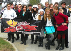 """<div class=""""source"""">Photo submitted</div><div class=""""image-desc"""">Central KY Community Theatre Youth Actors received a special invitation from Governor Beshear to participate in his Inaugural Parade on Dec. 13 in Frankfort. The Youth Actors are based out of the Opera House in Springfield, and enjoy the talents of students from Nelson, Taylor, Marion and Washington counties. Pictured, from left, are Haberlin Roberts, Mark Grider, Trevor Fitzpatrick, Natalie Warren, Jordan Barlow, Sara Thompson, Aaron Robinson, Hannah Harmon, Wesley Campbell, Gaubrie Humphress, Callie Mills, Gwendolyn Campbell, Joseph Mattingly, Corey Kieslich and Alex Mattingly. The Youth Actors next performance is Jan. 13-15, """"Return to the Forbidden Planet."""" For more information, go to centralkytheatre.com.</div><div class=""""buy-pic""""></div>"""
